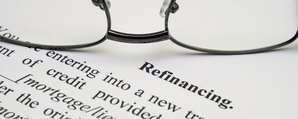 glasses on refinancing document