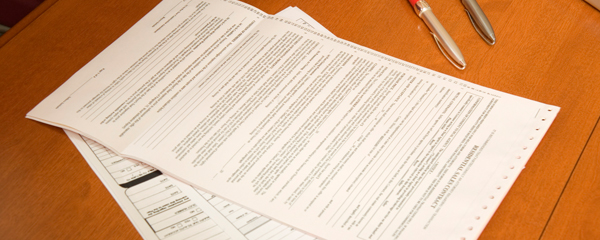 application forms on a desk