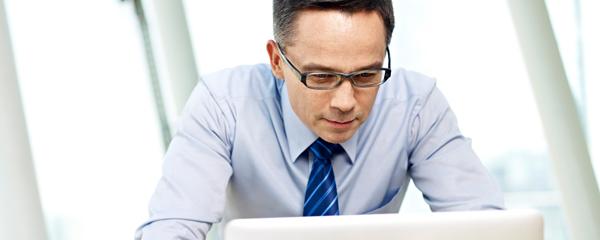 business man looking at computer